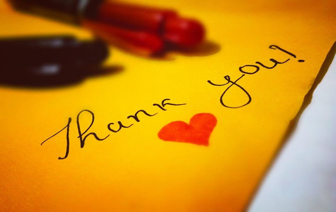 hand written thank you with heart